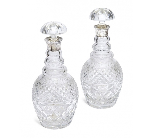 RoseberysA pair of cut glass decanters with silver collars