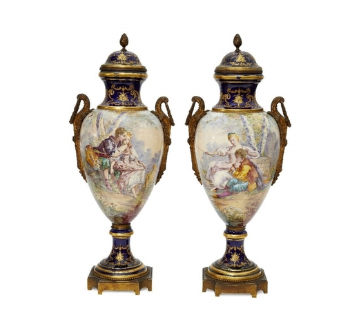 RoseberysA pair of Continental Sevres style porcelain and gilt metal mounted urns