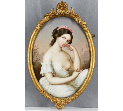 RoseberysA Continental porcelain oval portrait plaque of a young girl