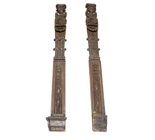 RoseberysA pair of Continental carved figural oak pilasters