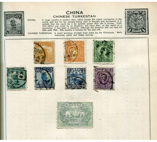 TooveysThree stamp albums containing world stamps.