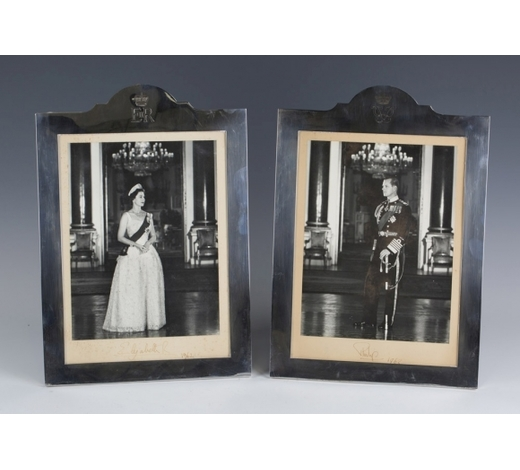 TooveysAUTOGRAPHS. A pair of black and white photographs signed by HM Queen Elizabeth and HRH Prince Philip and dated 1962 in ink to the mounts below the respective images