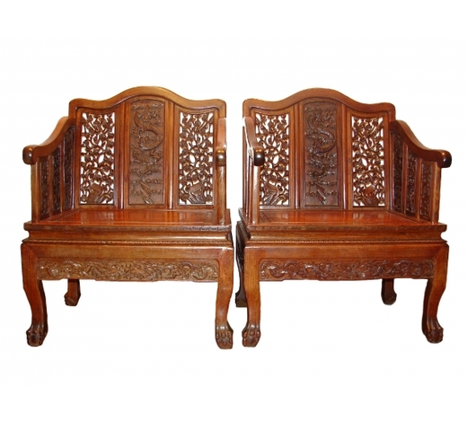 Arman AntiquesA Pair of Rare Imperial Chinese Huanghuali Armchairs with Dragons, 18 Century.