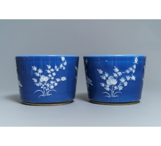 Rob Michiels AuctionsA pair of Chinese blue ground slip-decorated jardinières, 19th C.