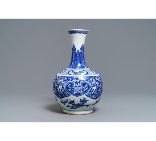 Rob Michiels AuctionsA Chinese blue and white bottle vase with dancers on a floral ground, 19th C.