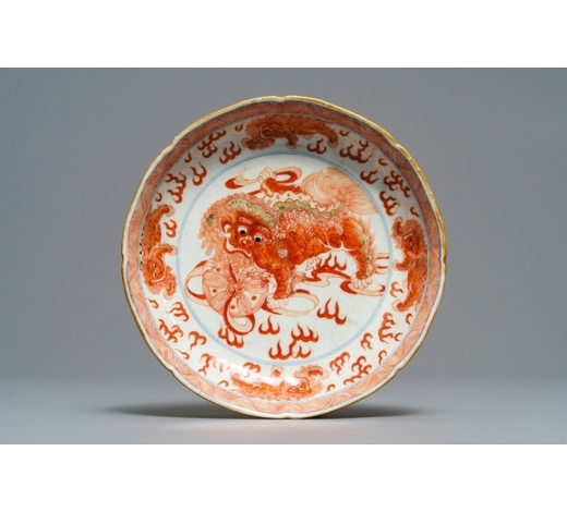 Rob Michiels AuctionsA Chinese blue, white and iron red 'Buddhist lion' plate, Qianlong mark, 18/19th C.