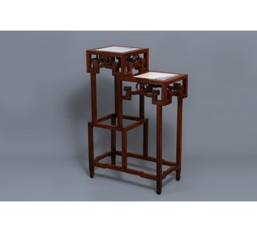 Rob Michiels AuctionsA double Chinese wooden display stand with marble tops, 19/20th C.