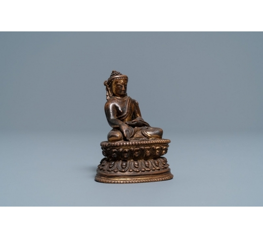 Rob Michiels AuctionsA Sino-Tibetan gilt bronze figure of Buddha, 16/17th C.
