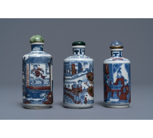 Rob Michiels AuctionsThree Chinese blue, white and underglaze red snuff bottles, Yongzheng marks, 18/19th C.