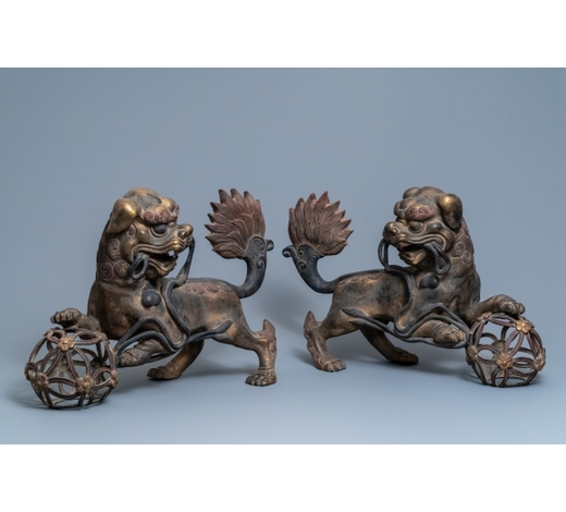 Rob Michiels AuctionsA pair of large Chinese gilt-lacquered bronze Buddhist lions, 19th C.