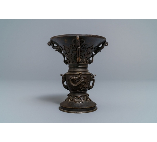 Rob Michiels AuctionsA Chinese relief-decorated bronze 'gu' vase with inscribed base, 18/19th C.
