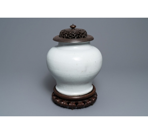 Rob Michiels AuctionsA Chinese monochrome white vase with a wooden cover and stand, Ming