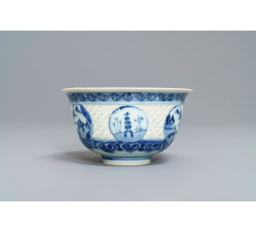 Rob Michiels AuctionsA Chinese blue and white reticulated bowl with landscape panels, Transitional period