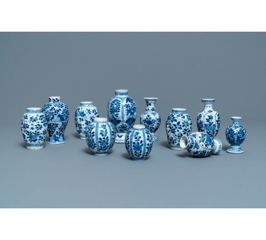Rob Michiels AuctionsEleven small Chinese blue and white vases with floral design, Kangxi