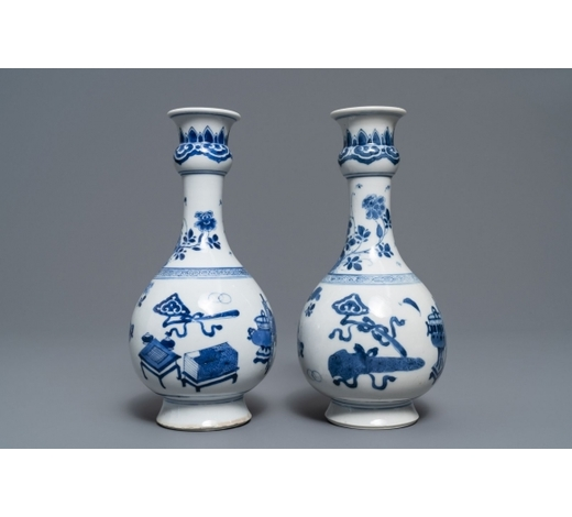 Rob Michiels AuctionsA pair of Chinese blue and white vases with antiquities and flowers, kangxi