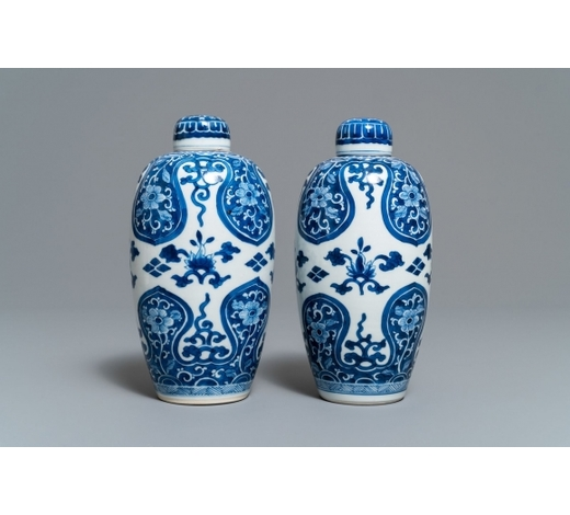 Rob Michiels AuctionsA pair of Chinese olive-shaped blue and white covered jars, Kangxi
