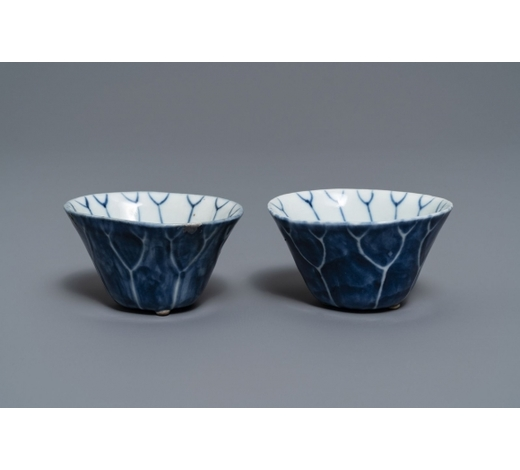Rob Michiels AuctionsA pair of Chinese blue and white 'lotus' cups, Kangxi