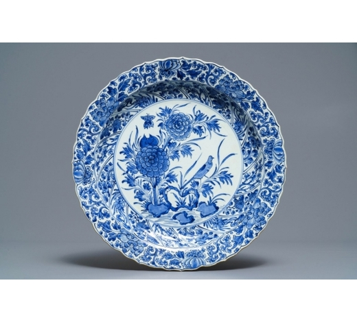 Rob Michiels AuctionsA Chinese blue and white moulded dish with a bird among flowers, Kangxi