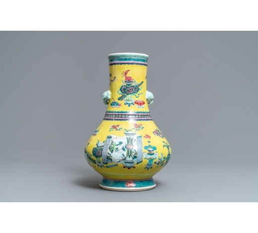 Rob Michiels AuctionsA Chinese yellow ground famille rose bottle vase with antiquities design, Yongzheng