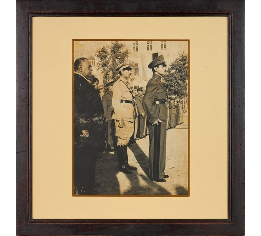 DreweattsA Young Mohammad Reza Shah Pahlavi, together with his brother, standing in uniform outside Golestan