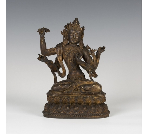 TooveysA Sino-Tibetan gilt bronze figure of the four-armed Manjushri