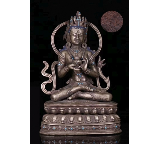 Empire Auction HouseA TIBETAN SILVER CASTED LIFELESS BUDDHA