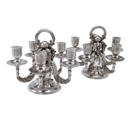 DreweattsGeorg Jensen, a pair of Danish silver Grape pattern candelabra