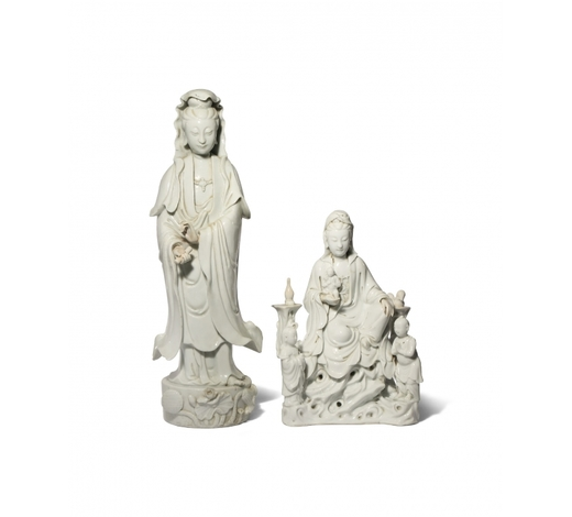 Woolley & WallisTWO CHINESE BLANC DE CHINE FIGURES OF GUANYIN 18TH AND 19TH CENTURY