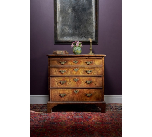 DreweattsA George II figured walnut and feather banded chest of drawers, circa 1735