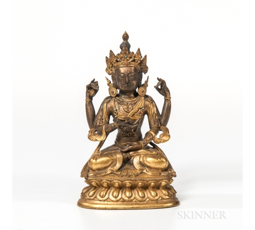 SkinnerGilt-bronze Figure of the Four-armed Vajrasattva, Sino-Tibet, 18th century or earlier, seated in dhyanasana, with a vajra in her rear r