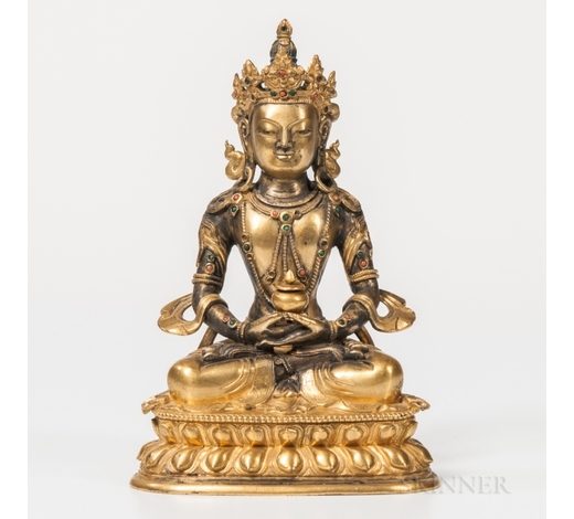 SkinnerGilt-bronze Figure of Avalokitesvara, Sino-Tibet, 18th century, seated in dhyanasana on a double lotus throne, with hands in dhyana wit