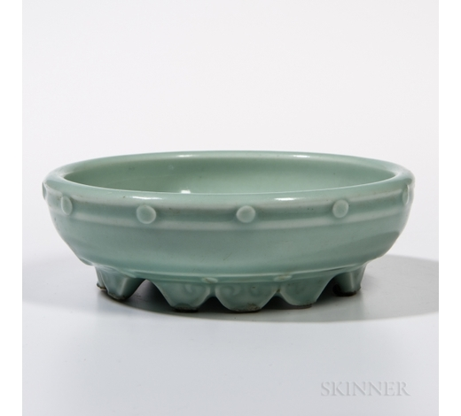 SkinnerCeladon Bulb Bowl, China, 18th century, the shallow bowl with rounded sides and a band of evenly placed studs on the exterior, with twe