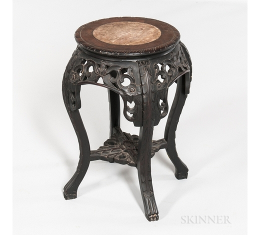 SkinnerSmall Marble-top Four-legged Stand, China, 19th/20th century, with round seat and cabriole legs, decorated with openwork floral and fol