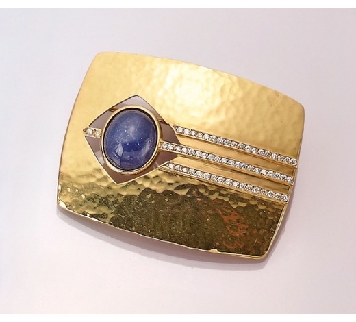 Henry's18 kt gold brooch with tanzanite and brilliants