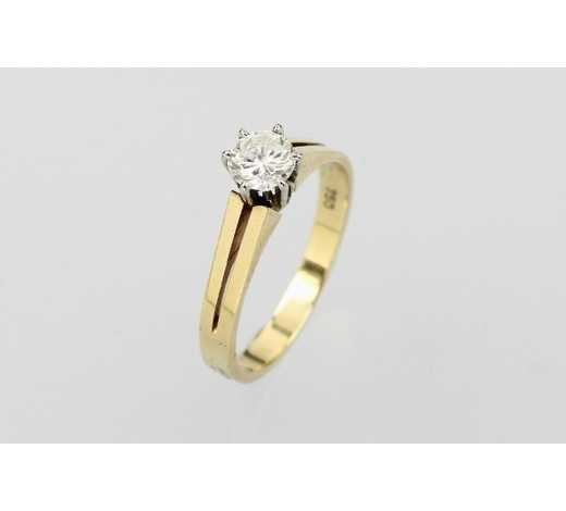 Henry's18 kt gold solitaire ring with brilliant