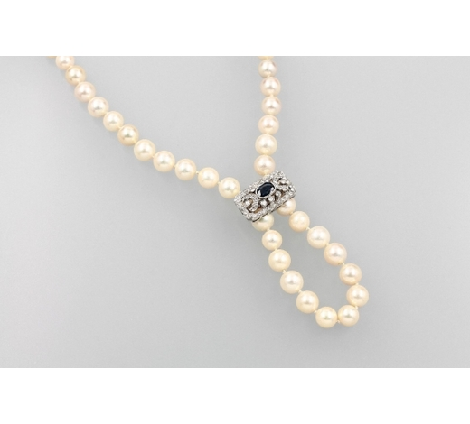 Henry'sLong necklace of Akoya cultured pearls with 14kt gold chain reducer with sapphire and diamonds