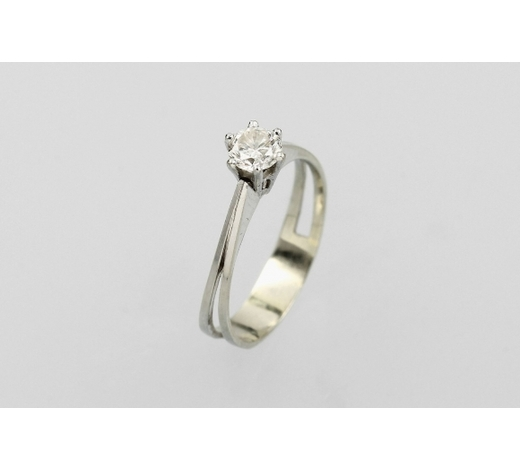 Henry's14 kt gold ring with brilliant solitaire