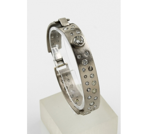 Henry's14 kt gold bangle with brilliants