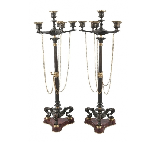 RoseberysA pair of French gilt and patinated bronze six-light candelabra