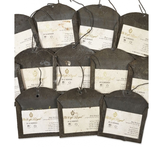 RoseberysA collection of approximately one hundred and fifty sheet metal wine cellar label holders