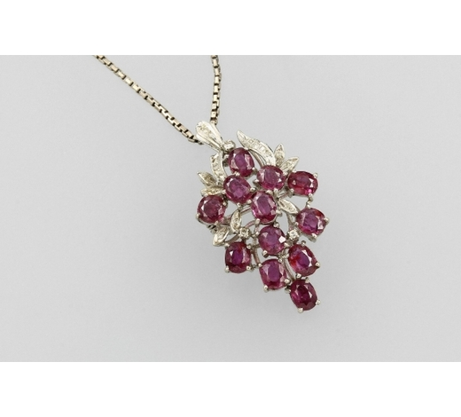 Henry's18 kt gold pendant/brooch with rubies and diamonds