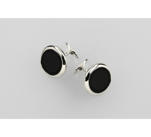 Henry'sPair of 18 kt gold cuff links with onyxinlay