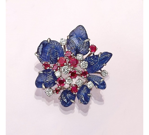 Henry's18 kt gold brooch with sapphires