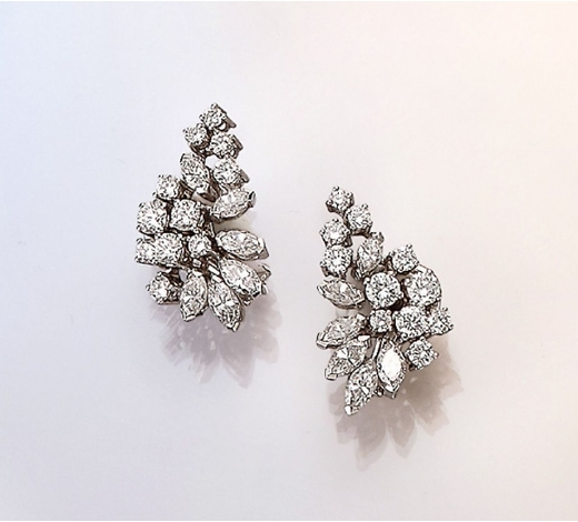 Henry's18 kt gold pair of clip earrings with diamonds