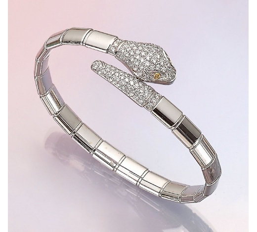 Henry's18 kt gold snake bracelet with brilliants