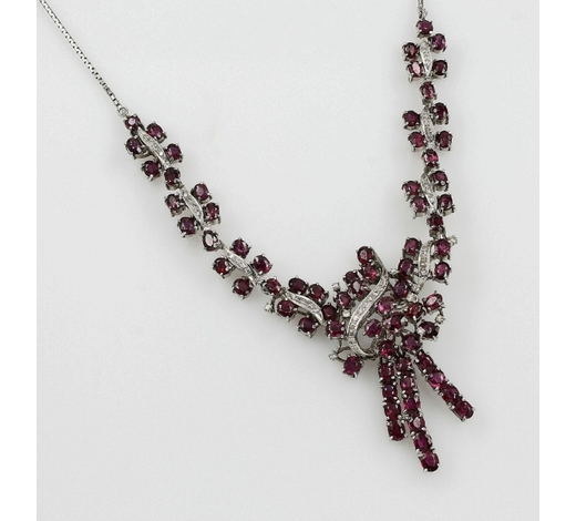 Henry's18 kt gold necklace with rubies and diamonds