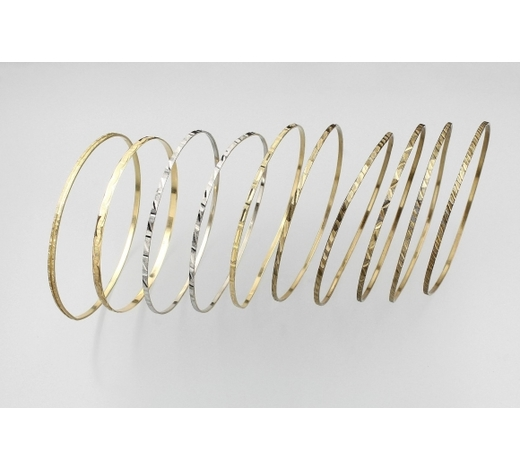 Henry's14 kt gold and 8 kt gold charm bangles