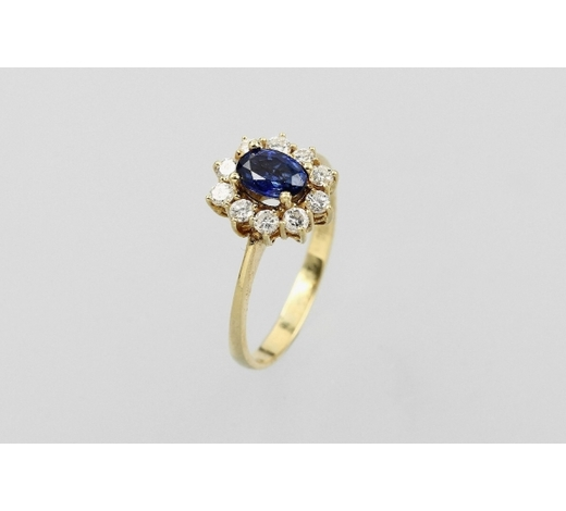 Henry's18 kt gold ring with sapphire and brilliants