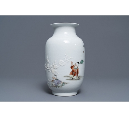 Rob Michiels AuctionsA Chinese famille rose relief-decorated vase with playing boys, Qianlong mark, Republic, 20th C.