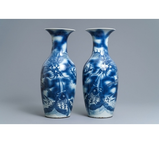 Rob Michiels AuctionsA pair of Chinese blue and white 'dragon and carp' vases, 19th C.